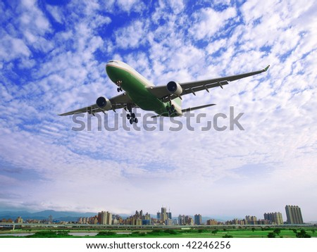 Airplane fly over buildings