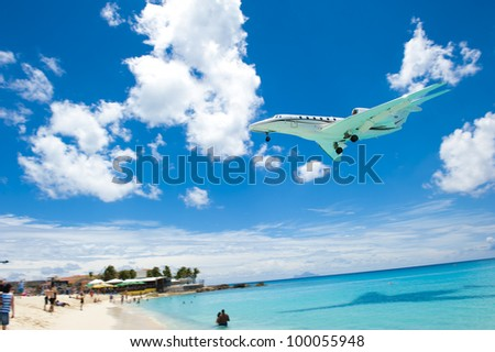 Airplane flying close to the beach.
