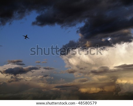 airplane flying close to the storm