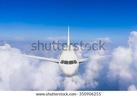 Airplane flying high above the clouds.