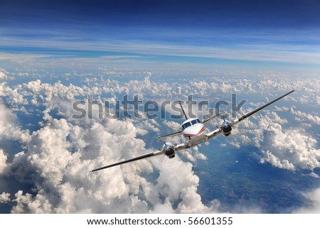 Airplane flying high above the clouds