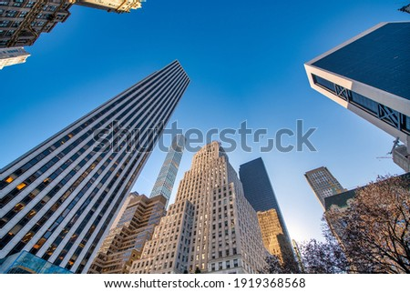 Airplane flying in sky among tall Uptown Manhattan skyscrapers, New York City. Stock photo ©
