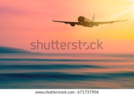 Airplane flying over blur tropical beach with smooth wave and sunset sky abstract background. Copy space of business summer vacation and travel adventure concept. Vintage tone filter effect color.  - Shutterstock ID 671737906