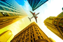 Airplane Flying over buildings in Boston, Massachusetts, USA,