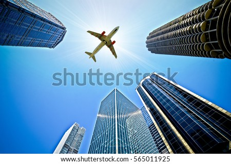 Airplane Flying over buildings in Chicago, USA #565011925