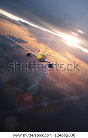 airplane flying through beautiful clouds at the sunset time with sunlight