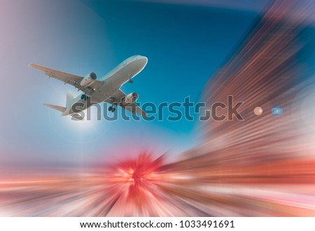 Airplane flying with dynamic colorful motion blur abstract background #1033491691
