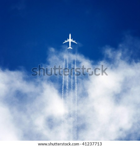 Airplane high in the sky - stock photo
