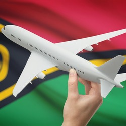 Airplane in hand with national flag on background series - Vanuatu