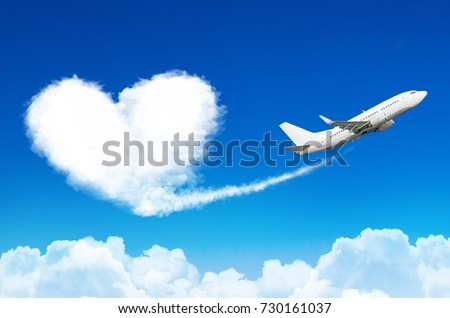 Airplane in the blue sky with clouds, left a trace in the form of a cloud of the heart