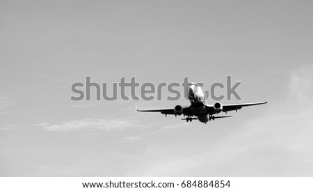 Airplane in the sky / An airplane is a powered, fixed-wing aircraft that is propelled forward by thrust from a jet engine or propeller #684884854