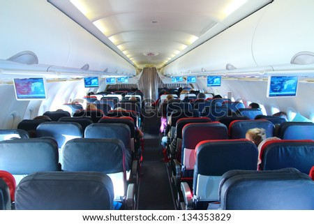 airplane interior - people sitting on seats