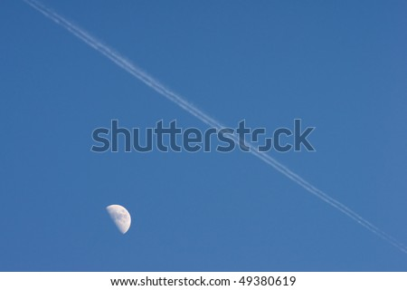 Airplane is flying over the moon in blue sky