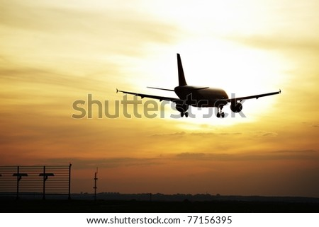 Airplane is landing at sunset, Prague Ruzyne Airport