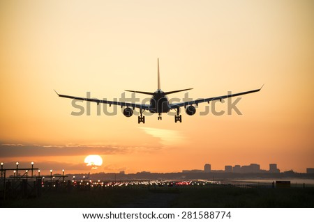 Airplane is landing during sunrise. #281588774