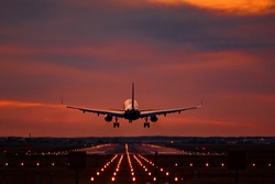 Airplane landing at sunset on otopeni airport