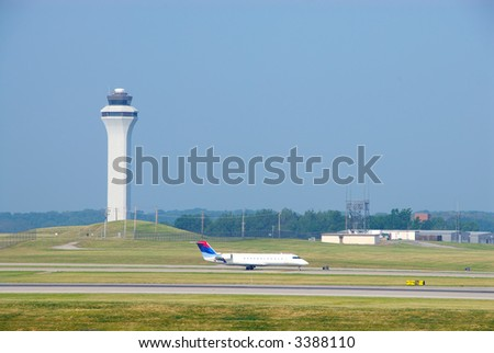 Airplane Landing In Front Of The Control Tower - Cincinnati Northern KY International Airport, CVG