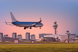 Airplane landing on airport in Amsterdam in the Netherlands