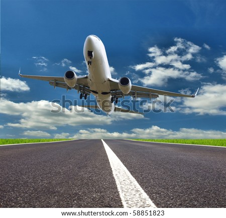 Airplane landing on runway - stock photo