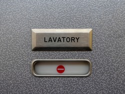 Airplane lavatory with red