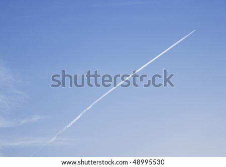 Airplane Leaving Jet-Steam Track On A Clear Blue Sky
