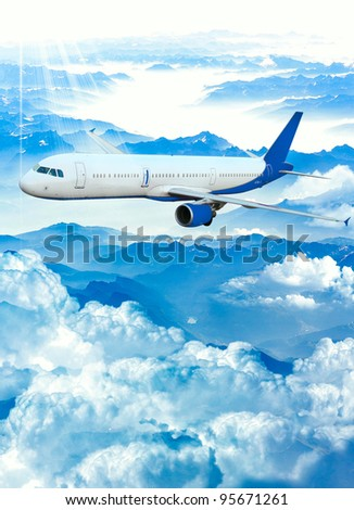 Airplane on a blue and cloudy sky. Airplane over the mountains