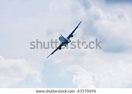 Airplane on a cloudy sky - stock photo