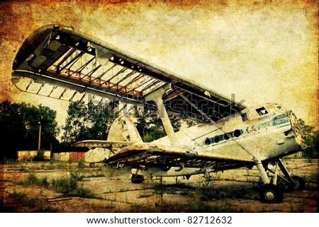 Airplane on grunge background