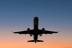 airplane on sunset sky - aircraft silhouette scenic sky
