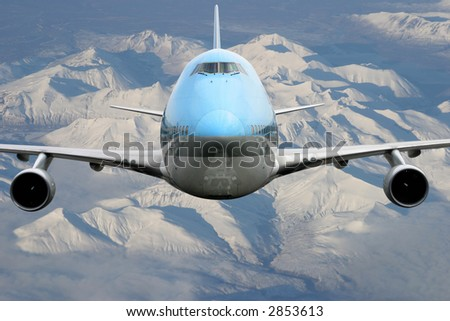 Airplane over Alaska - stock photo