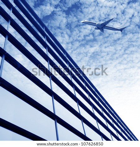 Airplane over the city?High-rise buildings. - stock photo