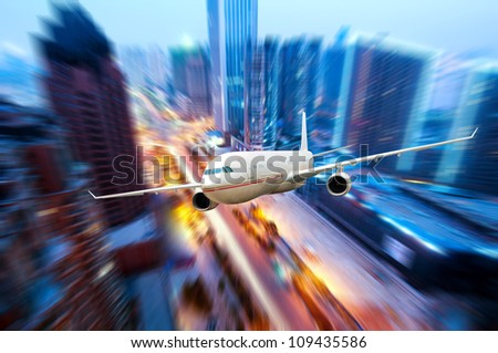 Airplane over the city�¯�¼?High-rise buildings.
