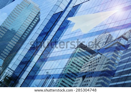 Airplane paper flying on window tower background, leader business concept #285304748