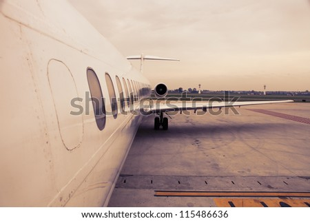 airplane parked in airport waiting for boarding passengers