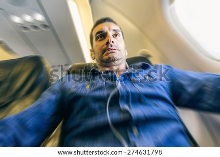 Airplane passenger in shock while the plane is in a turbolence area