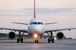 Airplane ready to take off from runway. A big passenger or cargo aircraft, airline. Transport, transportation, travel.