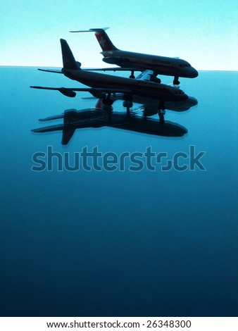 Airplane scale models on blue against a blue background