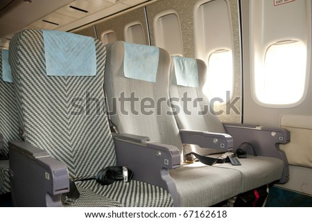 Airplane seat and window inside an aircraft