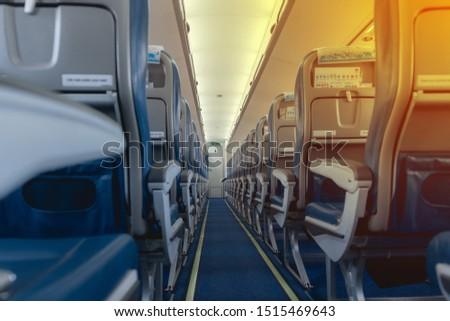 Airplane seats in the cabin economy class., Empty passenger airplane seats in the cabin #1515469643