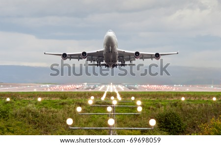 airplane take off at manchester airport england uk