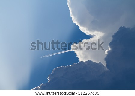 airplane takes off from the thundercloud
