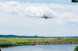 Airplane taking off at DCA airport. Boeing 737 max