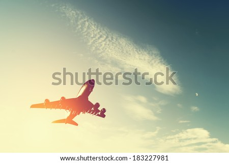 Airplane taking off at sunset. Silhouette of a big passenger or cargo aircraft, airline. Transportation