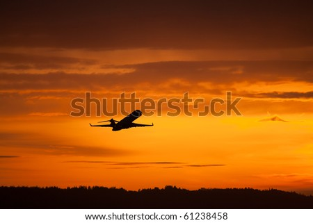 airplane taking off in sunset - stock photo