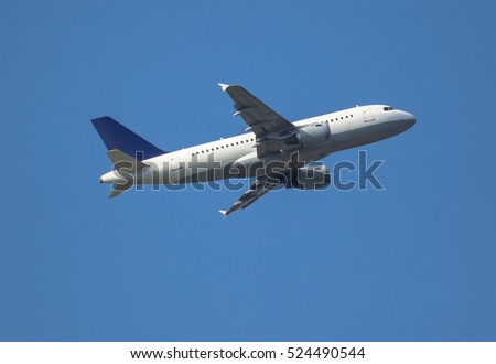 Airplane taking off in the blue sky