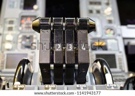 Airplane throttle levers photo.Four jet engine airplane throttle levers and instrument in the cockpit.Fuel on off knob switch of aircraft.Aircraft maintenance in cockpit.