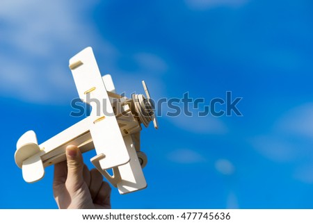 Airplane toy against blue sky - Shutterstock ID 477745636