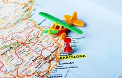Airplane toy on  Barcelona ,Spain  map and red pin - Travel concept