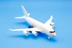 Airplane toy on blue background , travel concept.