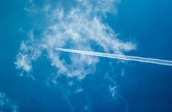 Airplane trail in the cloud and blue sky